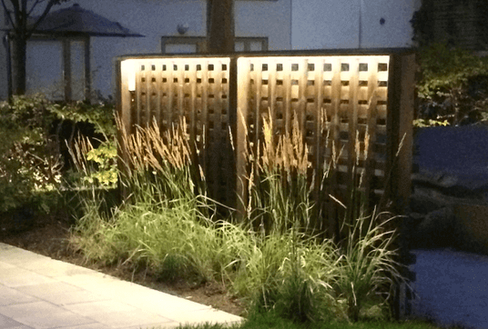 Picture of a illuminated garden fence